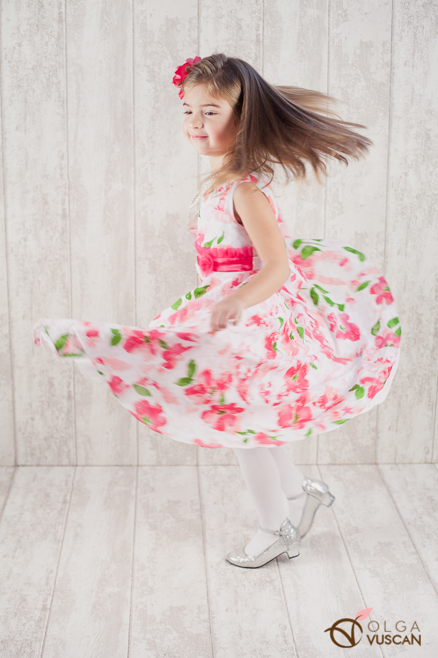 girl with twirling dress_images by Olga Vuscan